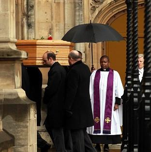 Times Series: Tony Benn's coffin arrives at the Palace of Westminster to be placed in the Chapel of St Mary Undercroft.