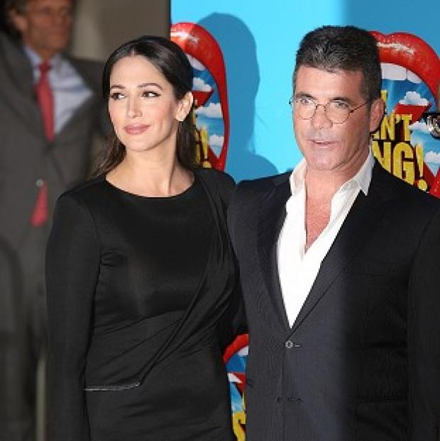 Times Series: Lauren Silverman and Simon Cowell attending the opening night of I Can't Sing! The X Factor Musical