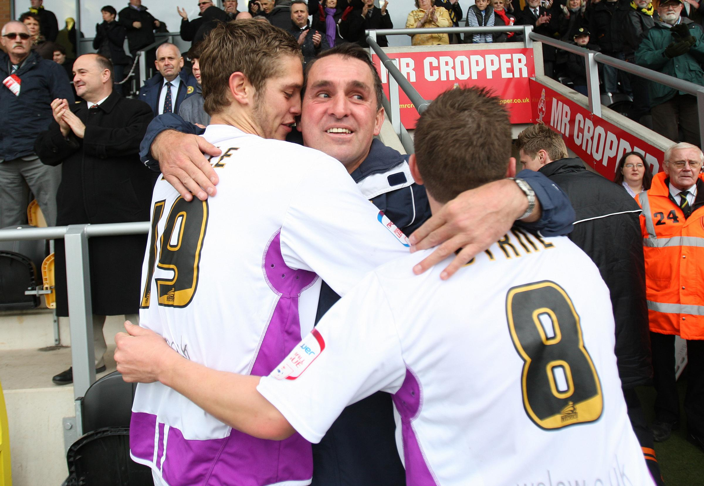 Jack Saville, Martin Allen and Mark Byrne celebrate after the Bees sealed safety in 2012. Picture: Action Images