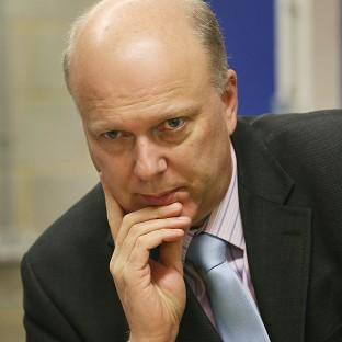 Justice Minister Chris Grayling has hit back at criticism of rules on prisoners' access to books