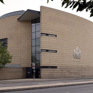 Five men are standing trial at Cambridge Crown Court accused of trafficking and raping eight girls