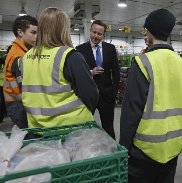 Times Series: Prime Minister David Cameron speaking to apprentices at a Waitrose food distribution centre