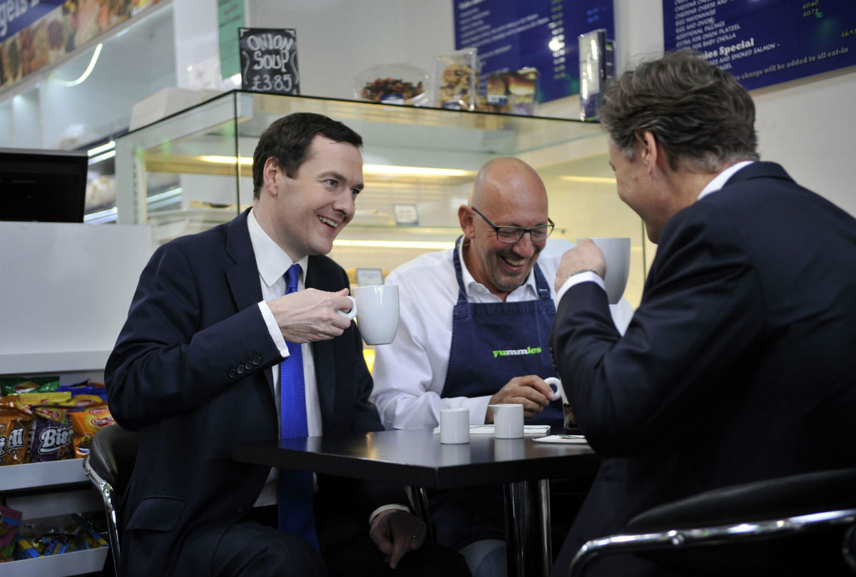 George Osborne has a coffee with Yummies Deli owner Lawrence Samuel and MP Matthew Offord.