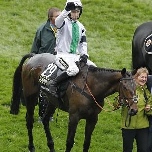 Times Series: Jockey Leighton Aspell celebrates winning the Crabbies Grand National on Pineau De Re