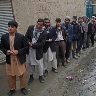 Afghan men line up for the registration process befor
