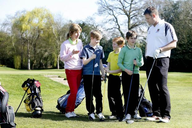 Kaz Donald, Arkley Club event organiser, with sports master James Fleet and boys from Belmont School, Mill Hill.