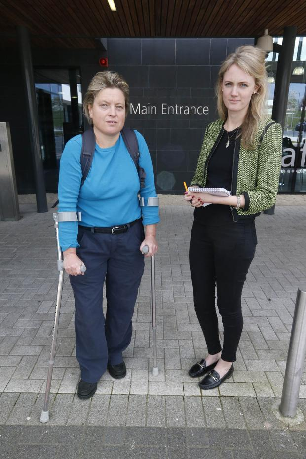 Times Series: Reporter Natalie O'Neill gets ready to walk from Finchley Memorial Hospital with patient, Cecilia Boosey.