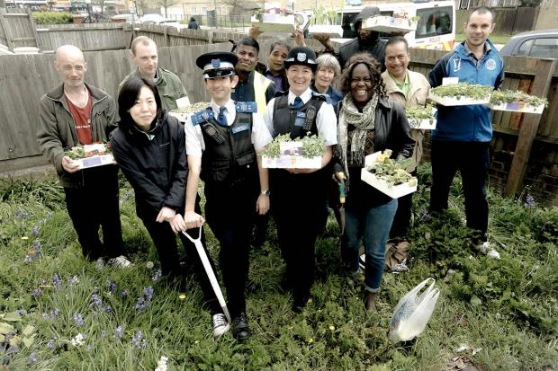 Police were joined by a group of volunteers to help give a spring clean to Homeless Action in Barnet
