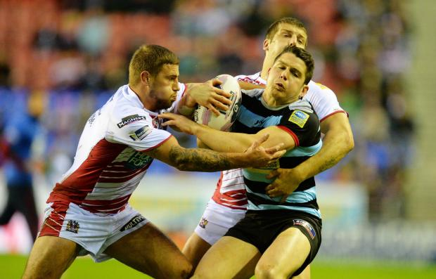 Wigan Warriors' Michael McIlorum (left) and London Broncos' Jordan Atkins (right) do battle. Picture: Action Images