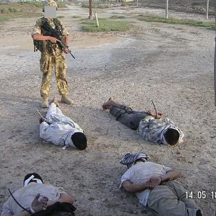 This image of detained Iraqis being g