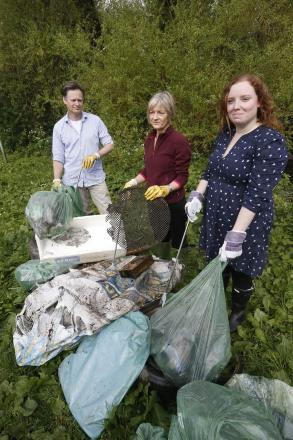 Volunteers clear filthy river