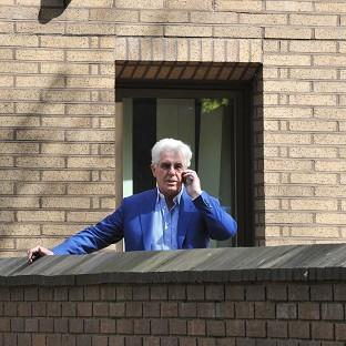 Times Series: Publicist Max Clifford makes a phone call during a break in his trial at Southwark Crown Court