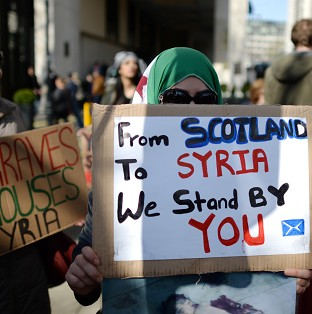 Women protesters campaign for more international involvement in the Syrian conflict