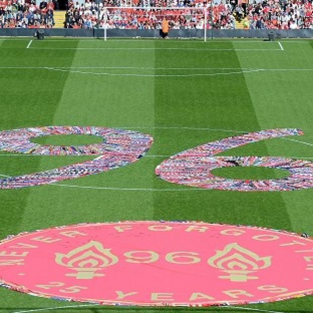 Times Series: Fans' scarves make up a 96, filling the centre circle before the Hillsborough 25th Anniversary Memorial Service at Anfield Stadium, Liverpool