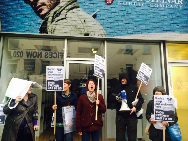 Anti-fascist campaigners stage protest outside store associated with neo-Nazis