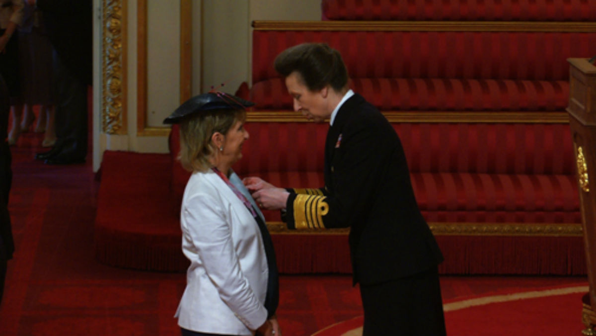 Shelley Gilbert receiving her MBE at Buckingham Palace.