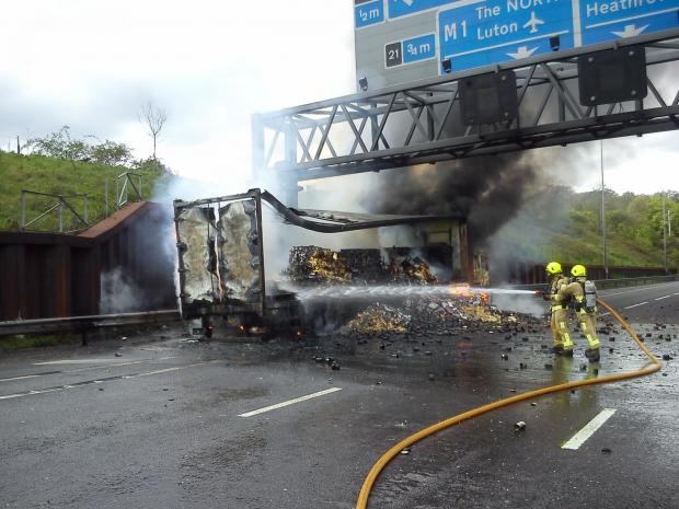 Times Series: The lorry was carrying a large quantity of cooking oil and tins of fruit and vegetables, which were exploding across both lanes of the motorway