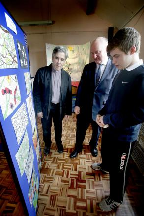 Totteridge Academy Sixth Former Conor Thomas and Reverend Tim Seago showing Councillor Richard Cornelius Totteridge Academy's work on William Morris.