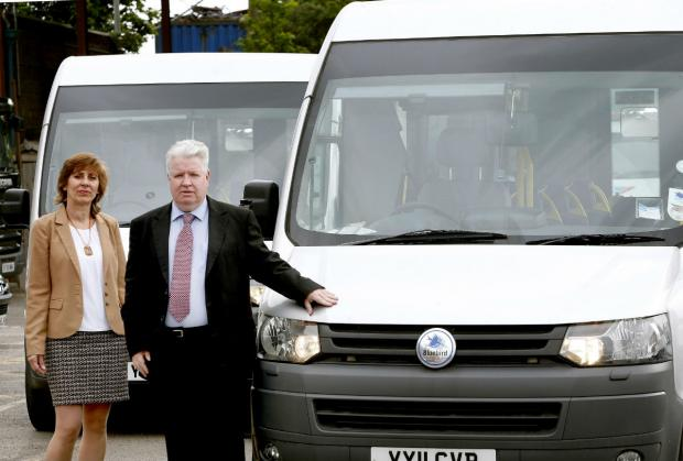 Marilyn Kendall, publicity and sustainability officer, and Richard Healy CEO of Barnet Community Transport with one of the charity's buses.