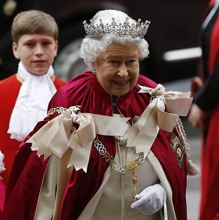 Times Series: The Queen arrives for the Order of the Bath Service at Westminster Abbey.