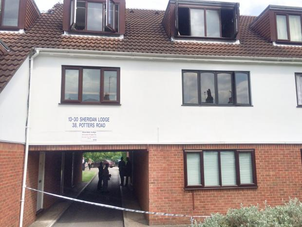 Times Series: Police have cordoned off the block of flats where the fire happened last night.