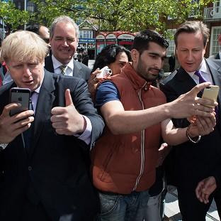 Mayor of London Boris Johnson and Prime Minister David Cameron posing for selfies while campaigning