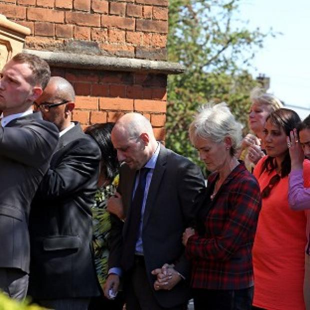Times Series: Judy Murray with Nino Severino follows the coffin of former tennis player Elena Baltacha into church.