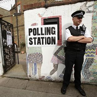 A police officer outside a polling station in Tower Hamlets