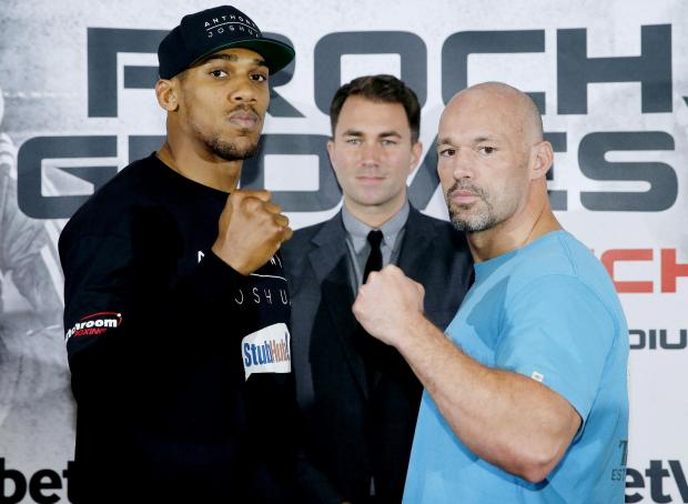 Anthony Joshua and Matt Legg face off ahead of Saturday's fight. Picture: Action Images