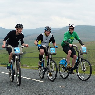 Dave Barker, Dave Parkes and Andy Sloan on the summit slopes of Buttertubs Pass in the Yorkshire Dales as they ride the stage one route of the 2014 Tour de France on Boris bikes for Macmillan Cancer Support.