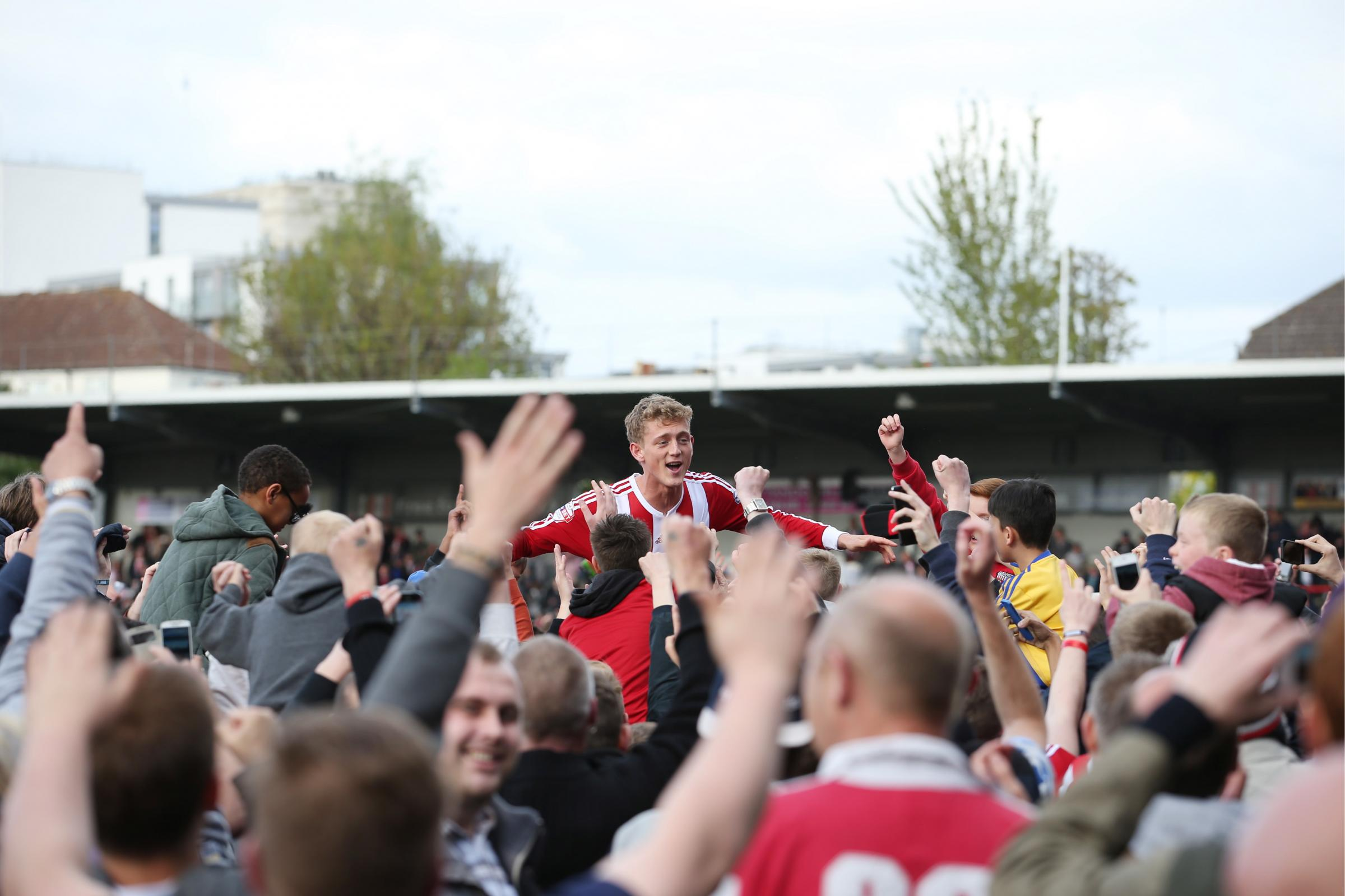 Brentford fans and players celebrate promotion last term. Picture: Action Images