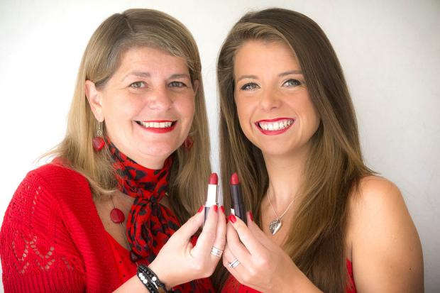 Times Series: Victoria Herd (right) and her aunt, Jill Hustwitt, strike a pose wearing their red lipstick.