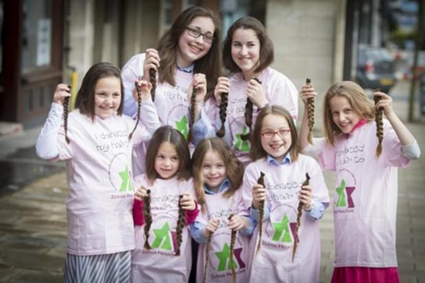 Girls have lucious locks chopped off for children with cancer