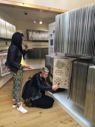 Students look at the John Lewis textile collection