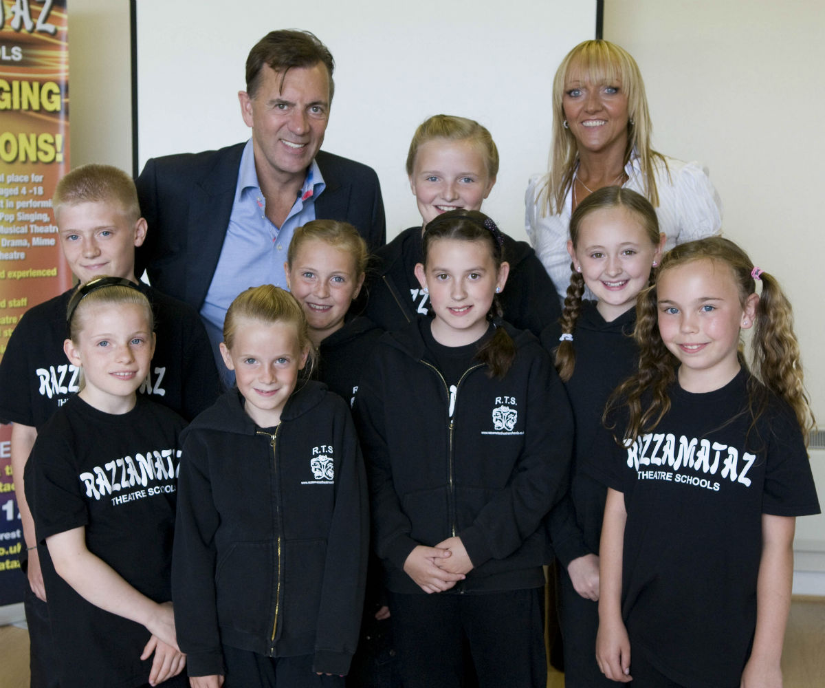 Business partners Duncan Bannatyne and Denise Hutton-Gosney with Razzamataz Theatre School pupils.