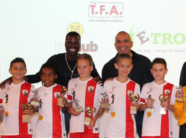 Football star surprises children at awards ceremony