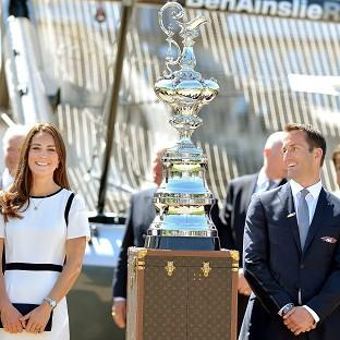 Times Series: The Duchess of Cambridge with Sir Ben Ainslie in front of the America's Cup during a visit to the National Maritime Museum, London