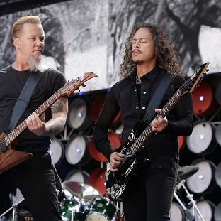 Metallica stars James Hetfield, left, and Kirk Hammett will be on stage for a Saturday headline set at Galstonbury