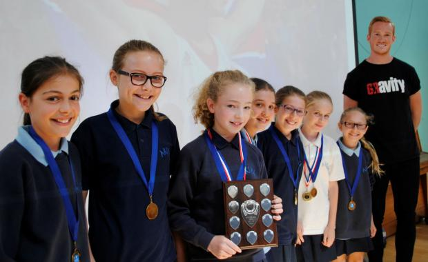 Greg Rutherford with Akiva School's netball team