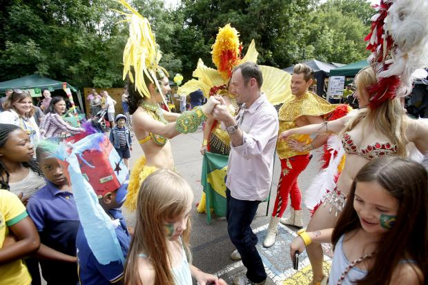 St Paul's Primary School headteacher Anthony David with the samba dancers
