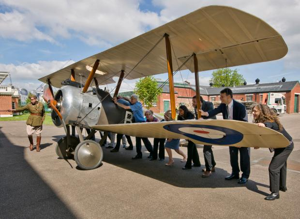 RAF Museum staff move the Sopwith Camel into the hangar