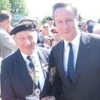 Times Series: Mervyn Kersh, a member of the Southgate Branch (75th) of the NVA, met David Cameron on his trip to Normandy earlier this month