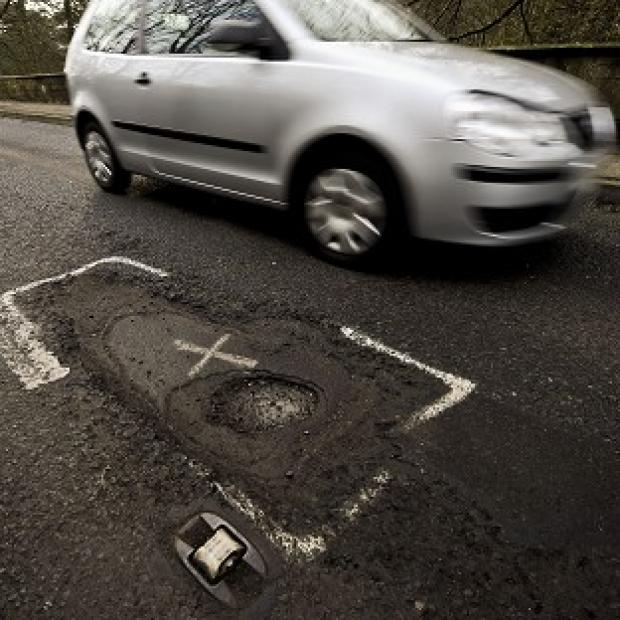 Times Series: A multi-million pound fund is being set up to tackle potholes
