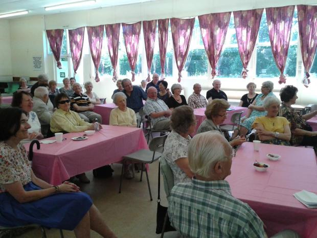 Magician meets drops in on retirees group