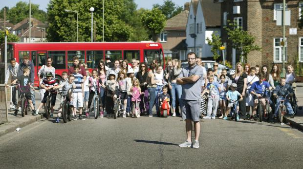 Justin Morley joins neighbours  and children who are calling for better safety measures in and around Chesterfield Road