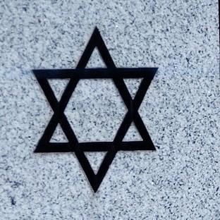 Police have condemned a 'racist attack' on a Jewish graveyard
