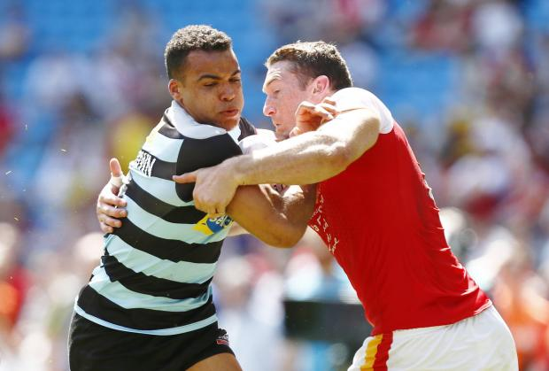 Mason Caton-Brown (left) is tackled by Catalans Dragons' Ben Pomeroy (right). Picture: Action Images