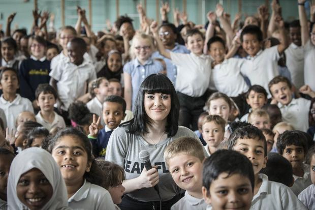 Christina Marie with children at Goldbeaters Primary School