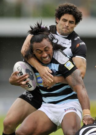 Broncos' Atelea Vea (front) holds of Widnes' Hep Cahill. Picture: Action Images
