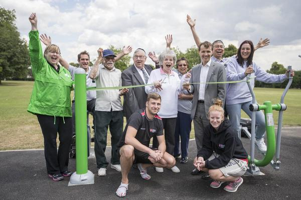 Councillor Helena Hart cuts a ribbon as fitness fanatics and councillors celebrate Barnet's new outdoor gyms.